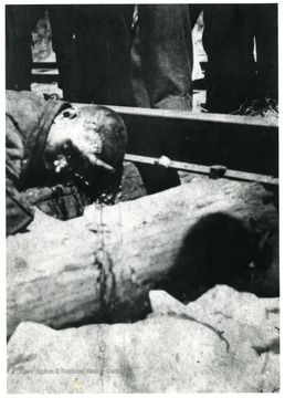 Body of a miner killed an explosion lying next to train track.