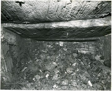 Large chunks of coal piled below the seam.