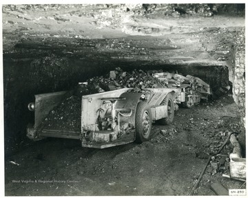 Rear end of loaded coal car in an underground mine.
