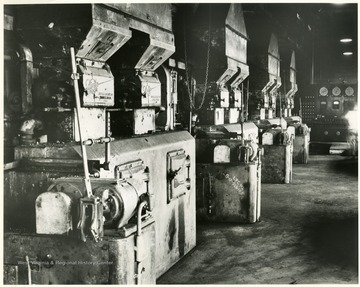 View of a row of boilers and equipment in an underground mine.