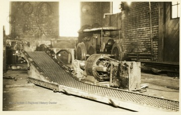 Close view of a conveyor and engine at a coal mine machine shop in Thomas, W. Va.