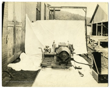 Machinery outside sitting on a white sheet.