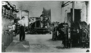 Man working in the Scarbro Mine Hoisting Room and Sub-Station, built in 1915-1916.