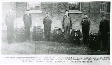 Group portrait of miners and rescue equipment.  This group took first place at competitions St. Louis.  From Left to Right: Frank Colline, Edward Graff, Howard Samuels, Andrew Lightfoot, R.P. Nicholls and Fred Lamb.