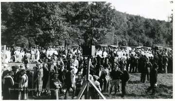 Crowds watch groups of men rehearsing mine safety procedures.