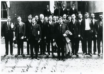 Group portrait of United Mine Workers leaders and lawyers at Jefferson County Courthouse, W. Va. Front Row, Left to Right; James M. Mason, C. J. Van Fleet, Samuel B. Montgomery, Harold Wilkins Houston, William Blizzard, John L. Lewis, Charles Franklin Keeney.