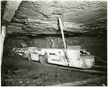 Two miners operate a Sullivan cutting machine.
