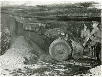 Two miners at Pursglove No. 15 cut coal preparatory to shooting it down for loading.