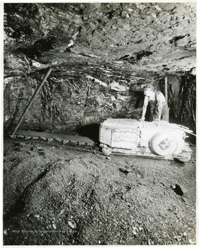 Miner using a very small cutting machine.