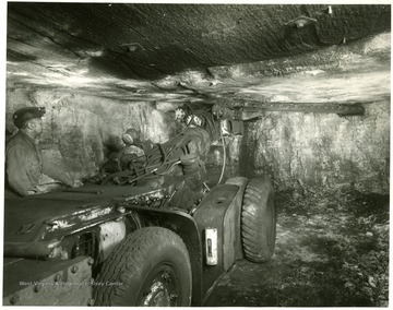 Miner works with cutting machine at Jamison No. 9 mine.