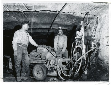 Two miners work with a Joy roof bolt drill at Jamison No. 9.