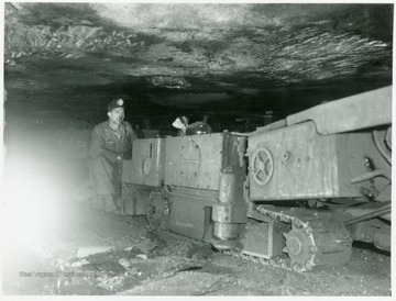 Miner running a continuous mining machine.