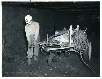 Miner with drilling machine at Jamison No. 9.