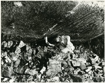 This miner is mostly likely testing for gas  in the Bethlehem Mine at Barrackville.