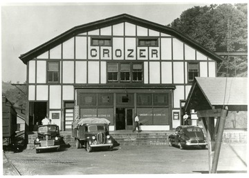Crozer Coal and Coke Co. building with a few cars and people out front.