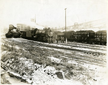 Train engine and filled coal cars outside of the preparation plant at Mine No. 32, Fairmont, W. Va.