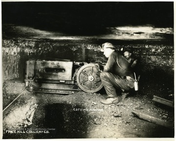 Miner operating a cutting machine.