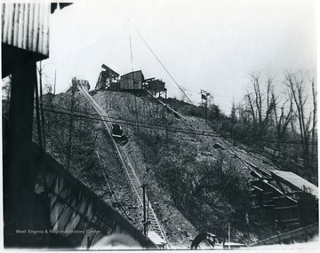Mine car traveling up hill to waste dump. 'For information on the Mountaineer Mining Mission See A&M 2491 (S.C.).'