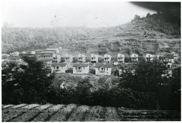 'I-79 went through this area. None of these buildings are standing. Shack would be to the extremem right (out of picture). Pursglove school outhouses are behind school buildings.'