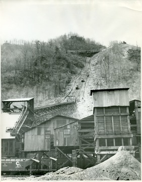 Stanaford Tipple loading coal cars.  Coal cars moving up and down hill on tracks.