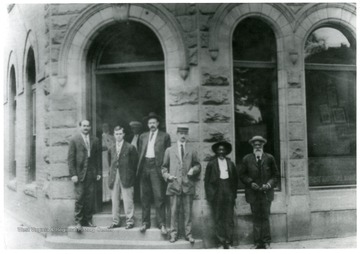 Officers in front of Alderson National Bank 'Left to right: James H. George, Cashier, H. B. Rowe, Asst. Cashier, L. E. Johnson, President and Dr. J. H. A. Miller Dentist.'