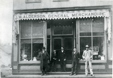 'J.M. Alderson(fourth from the left) and others in front of his store. (Credit; J.M. Alderson)'
