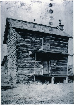 'Identification given in scrabook - Arthurdale Cabin. [Archives and Manuscripts] 1646 Neg. [and] print. Restored log house on Arthur Farm.'