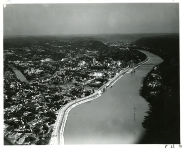 'Charleston, W. Va-Capitol in distance-at junction of Elk River with Kanawha. Boulevard occupies in great part originial section of James River and Kanawha Turnpike. Here old stage coaches ferried across the river.'