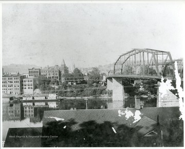 View of Charleston, West Virginia with bridge over river on right.