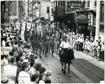 Eugene A. Carter rides his horse in front of a parade in Charleston, W. Va.