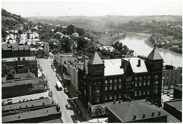 View of Fairmont next to the river. 'Before Watson Hotel was torn down on the corner of Main and Madison St.'
