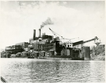 'Monongahela Power Company's multi-million dollar power station at Rivesville near Fairmont is typical of the industrial renaissance which has occured in the valley in four decades. The station went into service in 1916-17 and has grown continuously the last turbine-generator going 'on the line' three years ago. Total capability is in excess of 300,000 kw. The station is interconnected with other Monongahela facilities and with other companies stretching across the nation. R. T. Payne is the manager.'