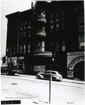 The Watson Hotel with cars parked out front.