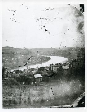 Postcard from the East Side in Fairmont, West Virginia. Houses on the West Side can be seen near the Suspension Bridge and Monongahela River.