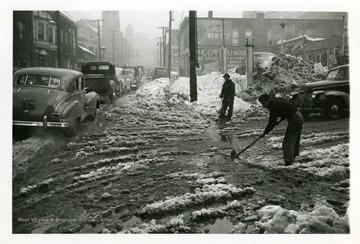 Two men are shoveling snow in Fairmont, West Virginia after the big snow storm of 1950.