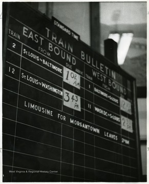 East Bound's train schedule from St. Louis and West Bound's train from Baltimore and Washington D.C. are listed on the Train Schedule Board in the train station at Grafton, W. Va.