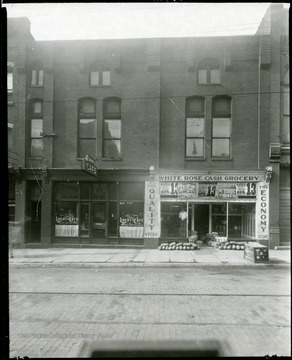 Exterior view of the Liberty Cafe and White Rose Cash Grocery Store in the Cohen Building in Grafton, W. Va.