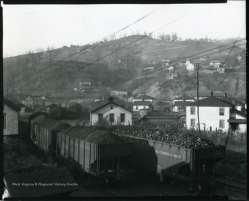Several Baltimore and Ohio Coal Cars on driving on railroad tracks at an unidentified coal mining community near Grafton, West Virginia.