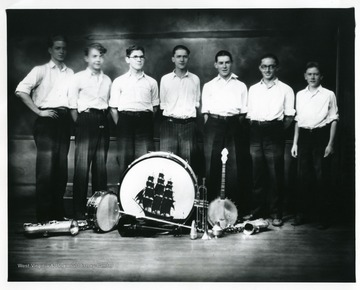 Group portrait of members of the High Hatters Orchestra in Graf., pose for a group portrait.