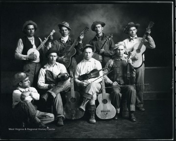 The Moatsville String Ticklers band pose with their instruments. None of the musicians are identified.
