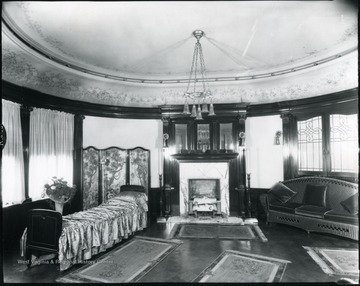 Interior view of room with a fireplace and furniture in the Bartlett home.