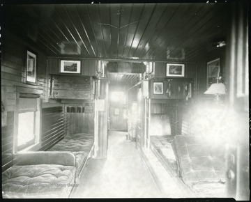 Interior of Caboose showing beds and seating area on the B&O railroad in Grafton, W. Va.  Sign in car reads 'Spitting on the Floor Prohibited.'