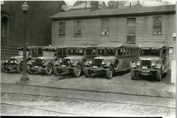 Five Bartlett Brothers buses in a parking lot, Grafton, W. Va.