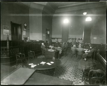 People sitting in the court room of the Taylor County Court House, Grafton, W. Va.