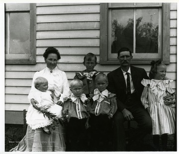 A group portrait of Otto and Annie Betler's family. Rear: Anna Hassig Betler, Henry Otto Betler, Otto Fredrich Betler, and Elsie Anna Frieda Betler. Front: unidentified, unidentified, and Lou Betler.