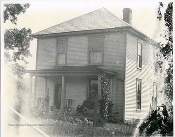 The front of a two-story wooden house possibly in Helvetia, West Virginia is shown in this photograph.