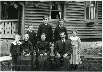 'Front Row - Walter Burky, Mrs. Dubach, Elise Dubach Burky, Fred Burky, Julia Burky; Back Row - Werner Burky, Fred Burky, Jr., Ernst Burky.'