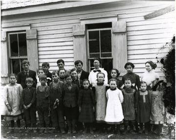 One older lady stands in the back row with children.