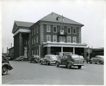 Several automobiles are parked in front of the C and O Railroad Depot in Huntington, West Virginia.