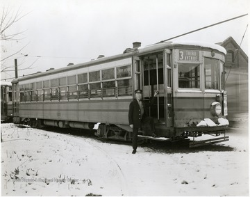 Driver stands at door to his Third Ave. trolley.